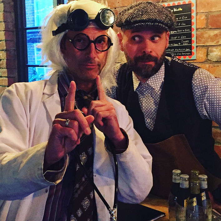 Costumed event host with bartender
