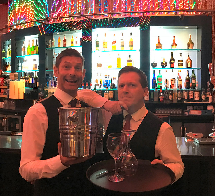 Baz 'n' Roop are waiters...or are they entertainer!